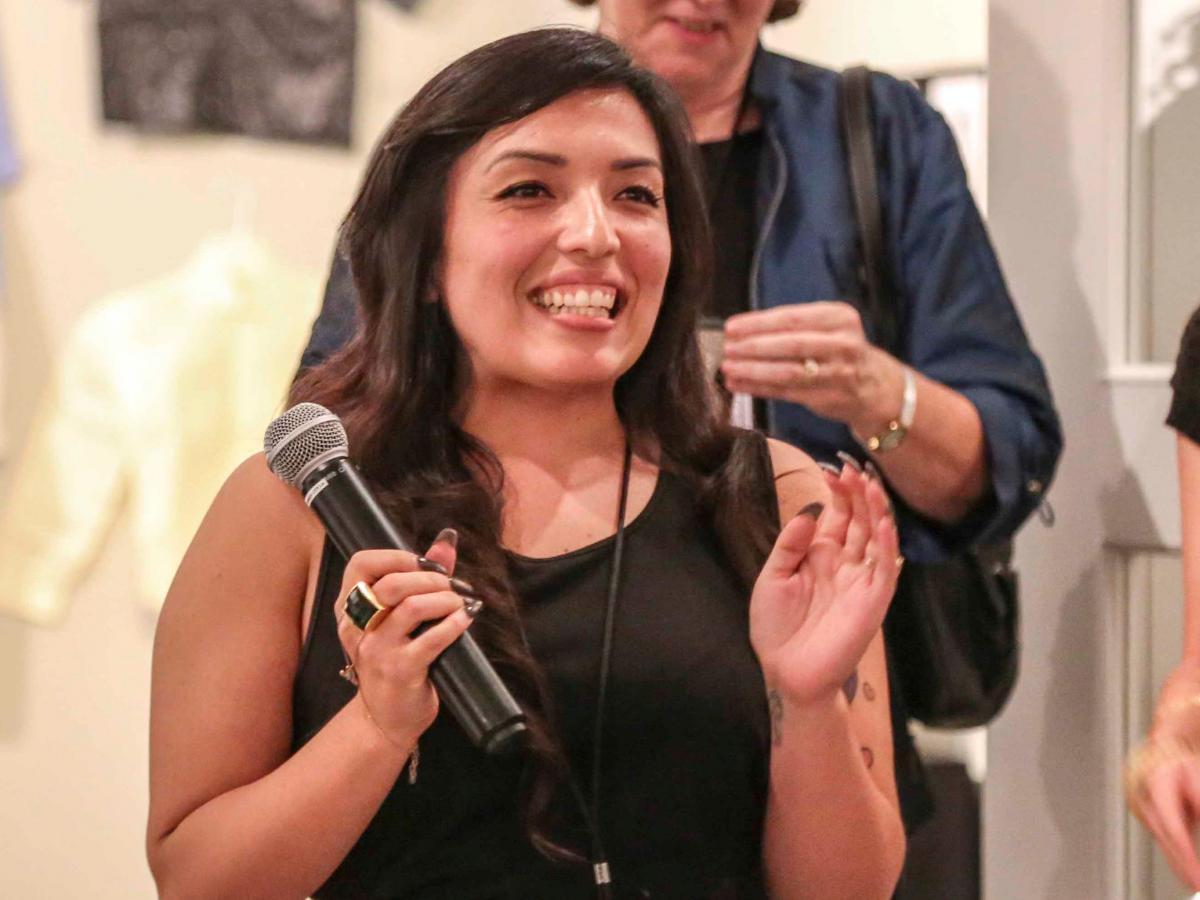Christina, then Alumni Representative on the Board of Directors, at the Ryman Arts 25th Anniversary Student Exhibition