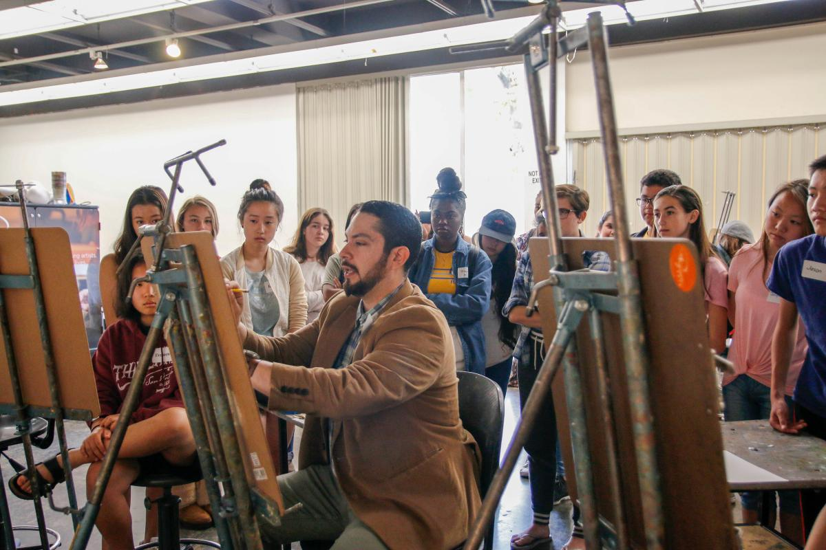 Master teaching artist Sergio Rebia leads a drawing demonstration on Application Day at Cal State Fullerton.