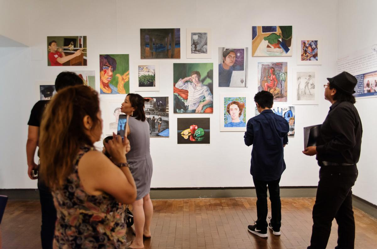 Ryman Arts graduates and their family enjoy the Student Artwork Exhibition in CSUF galleries
