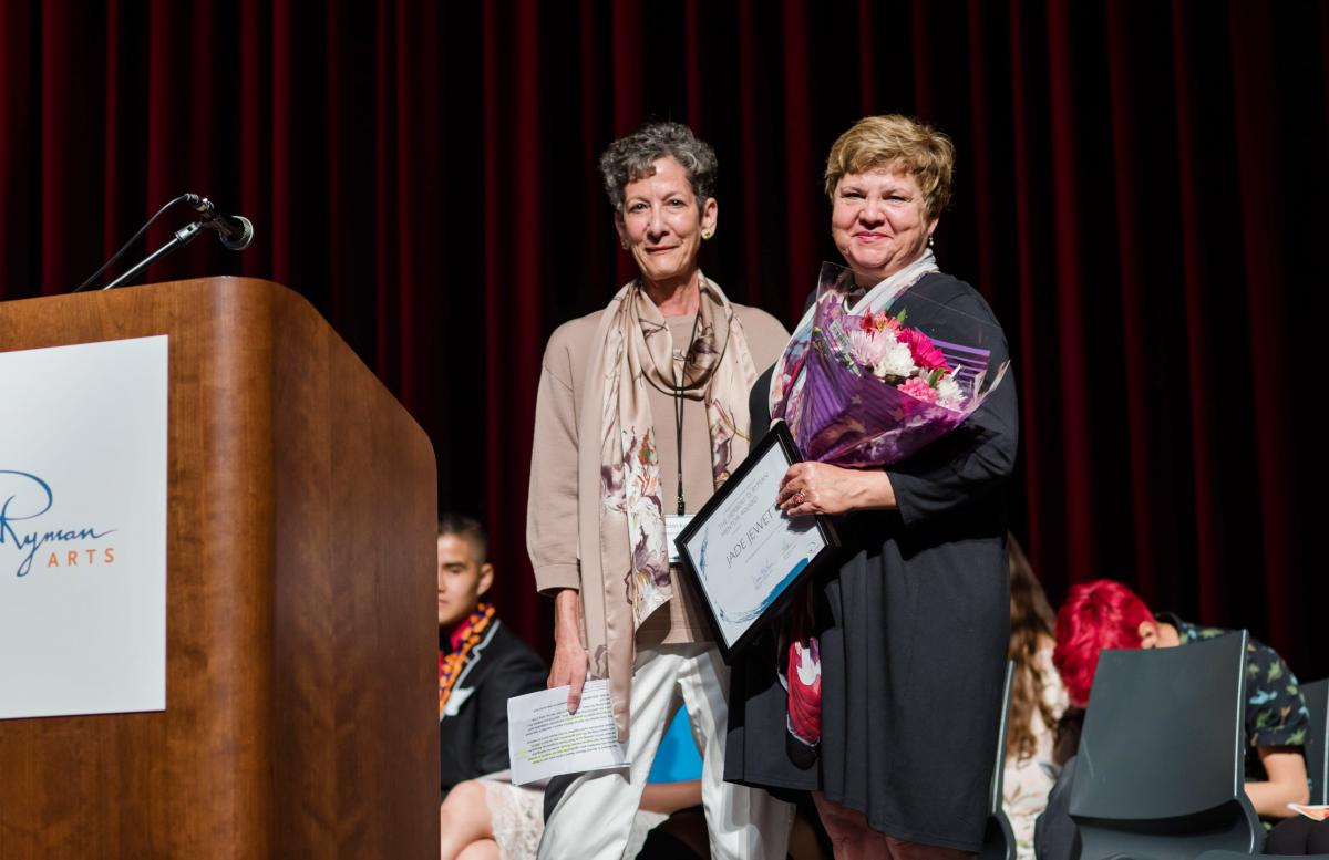 Robin Kalota presents Jade Jewett with the 2019 Herbert D. Ryman Mentor Award