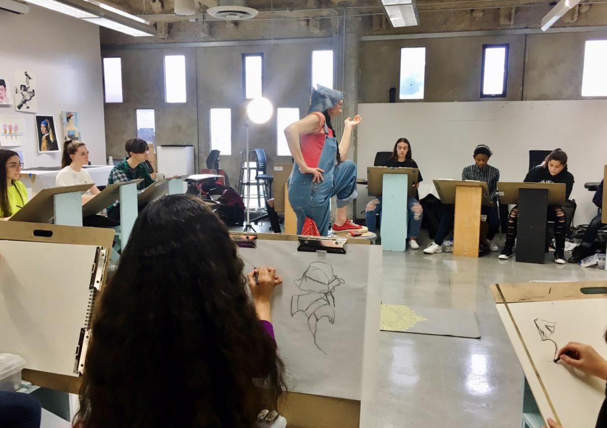 Master Teaching Artist Michelle Mary Lee's class practice their observational figure drawing skills with a live costumed model