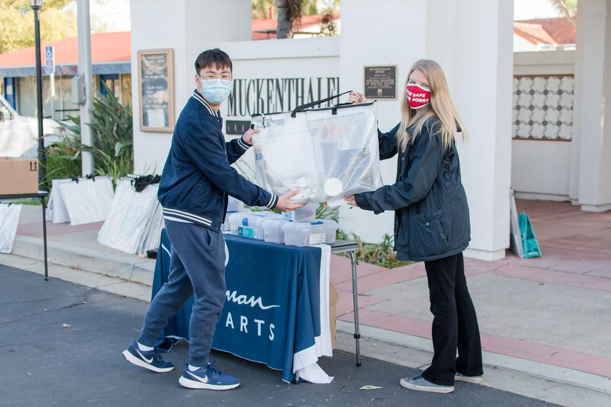 Student Nathan Song (Ryman '21) receives his art supplies from Education Manager Rebecca Tuynman at The Muckenthaler Cultural Center in Fullerton