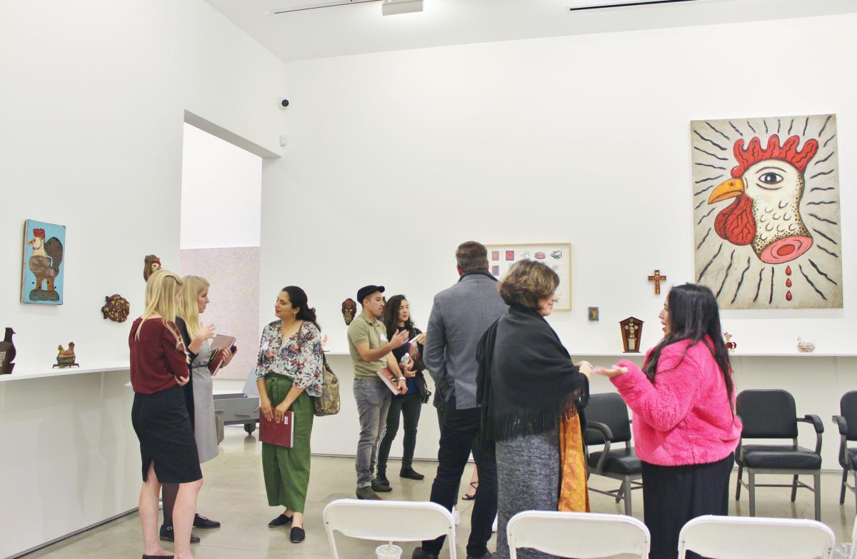 Ryman Arts Creative Hour attendees socializing after the panel at Edward Cella Art + Architecture