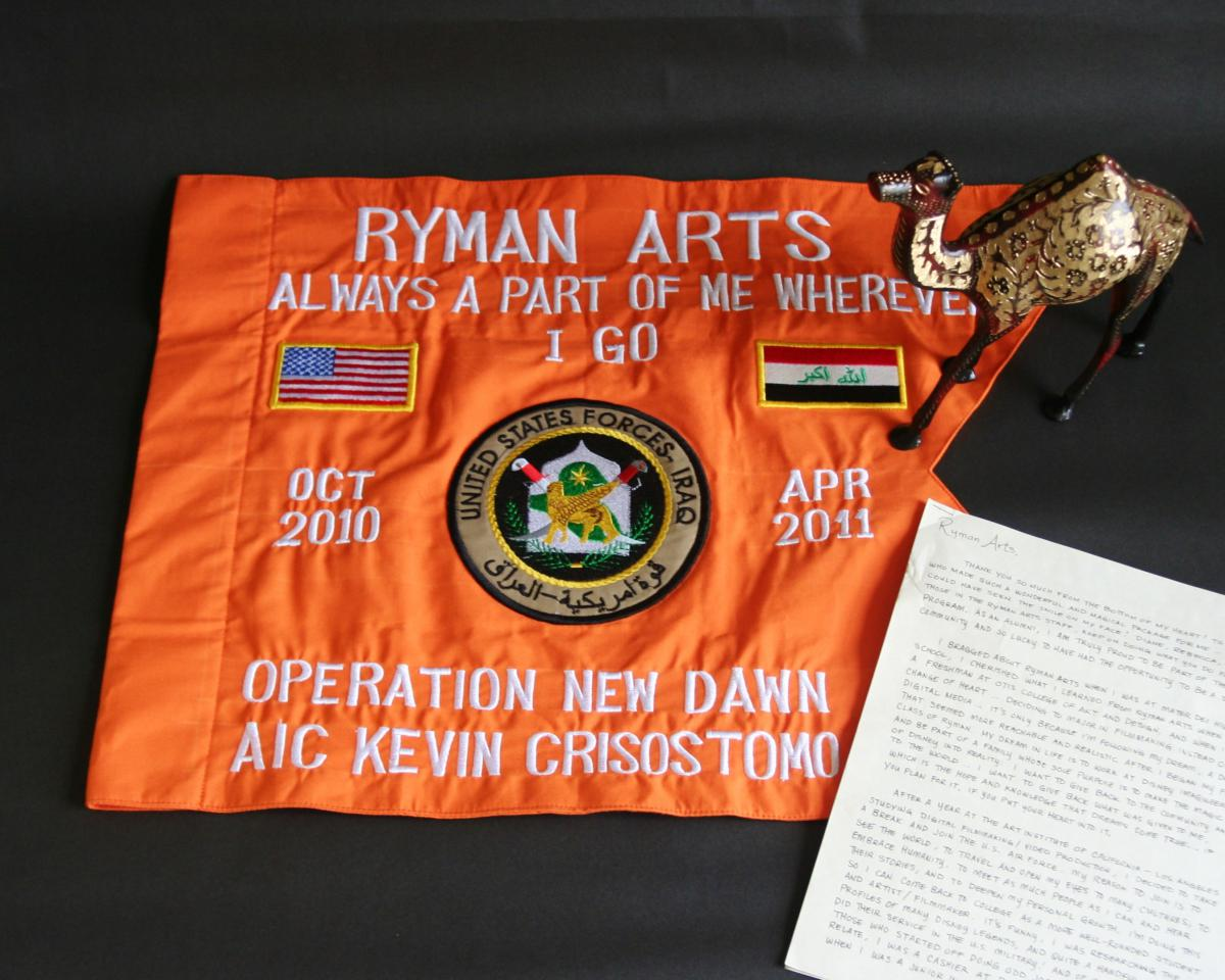 During his deployment, Kevin C. (Ryman '06) wrote letters Ryman Arts and sent this flag from his time in Iraq