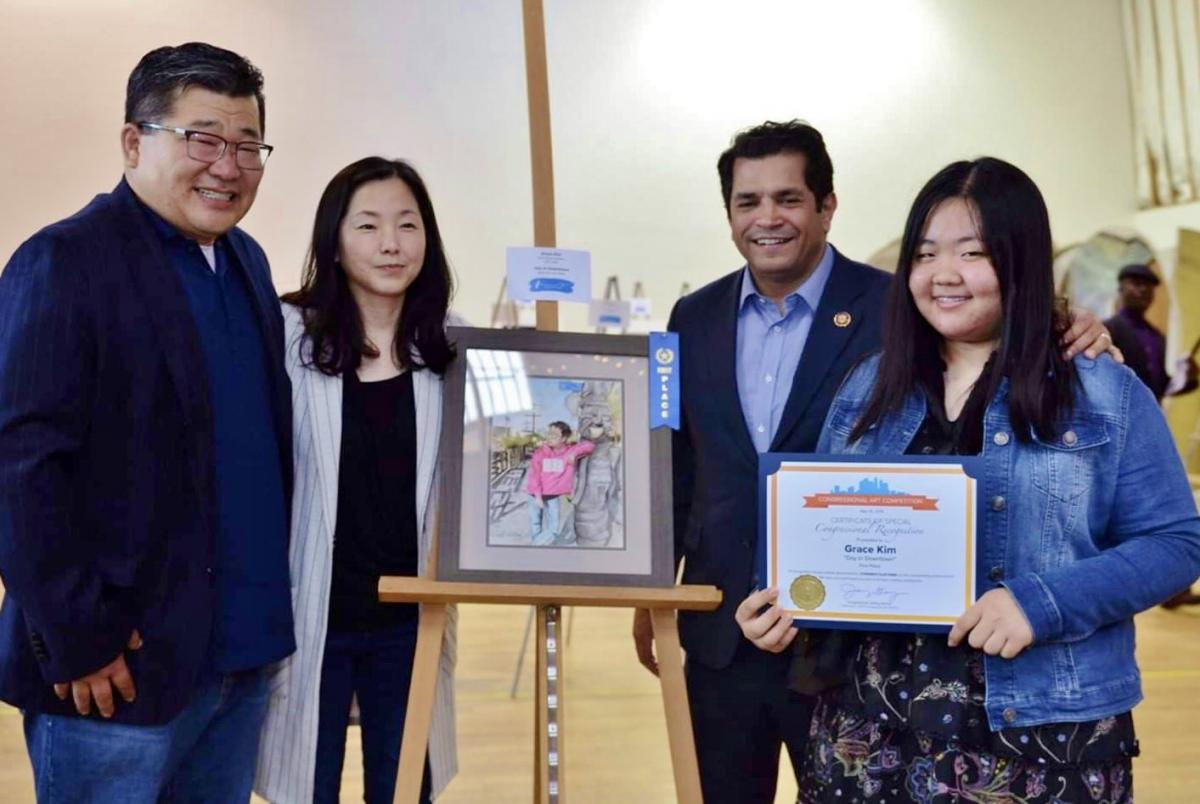 Grace Kim's parents, Congress Member Jimmy Gomez, and Congressional District Art Competition Award Grace Kim (Ryman '20), 34th District