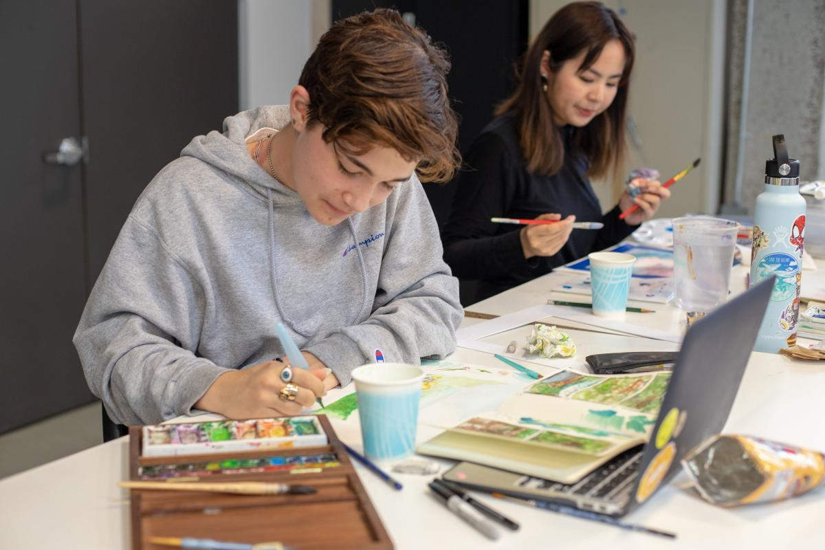 Ryman Arts artists work on their watercolor paintings at the studios of Otis College of Art and Design