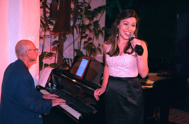 """Nelson Cole (on piano) and Juliana Hansen (vocals) perform """"A Kiss Goodnight"""" written by Richard Sherman"""
